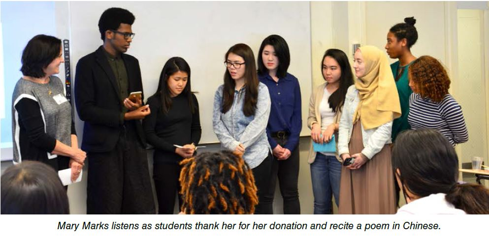 Mary Marks Listens as students thank her for her donation and recite a poem in Chinese